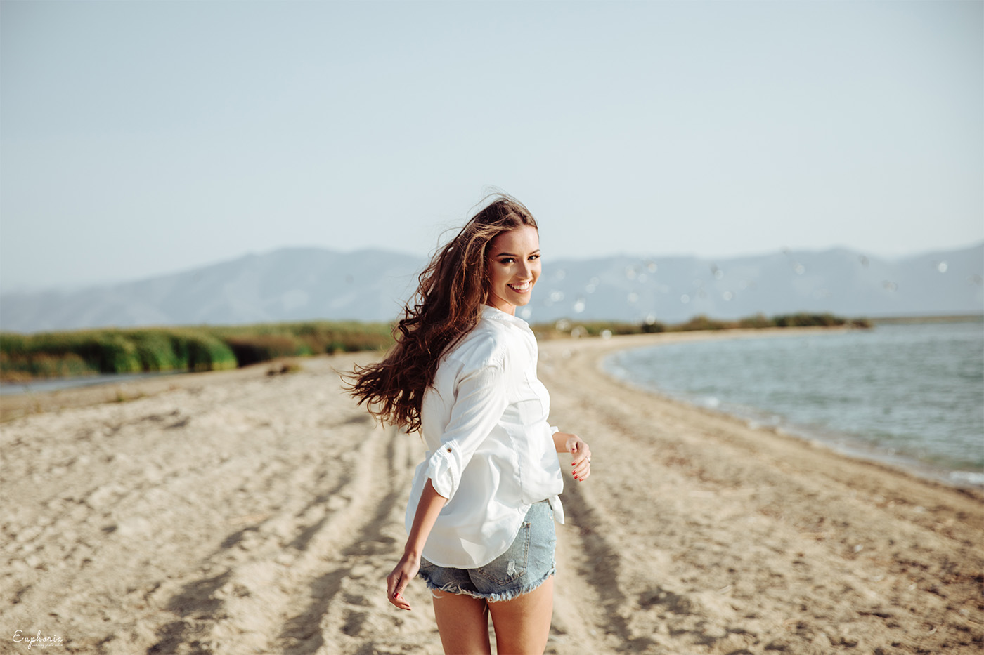 In the picture a classy girl has running on a beach, it was a nice idea to choose Armenia as a photoshoot location