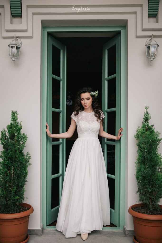 A picture from wedding in Georgia, Tbilisi, Bride Natia posing near green modern doors
