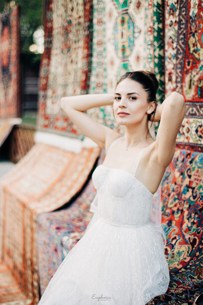It was a great idea to photograph the bride Mariam in Vernissage with colorful Armenian carpets in the background