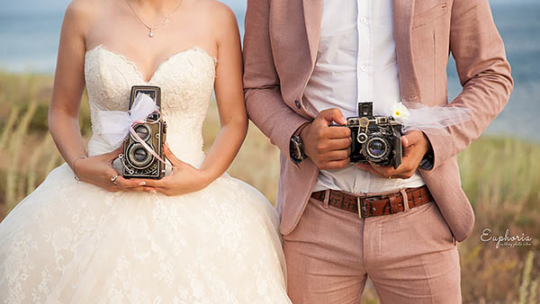 Euphoria wedding, armenian couple with old film camera's in Lake Sevan